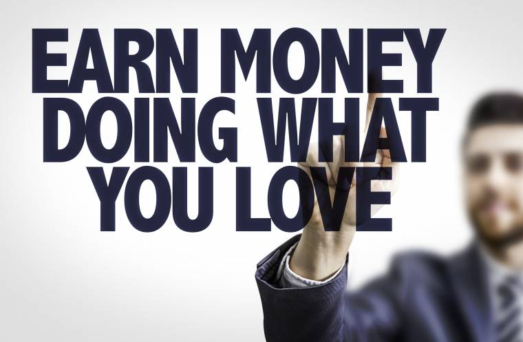 Business man pointing the text: Earn Money Doing What You Love