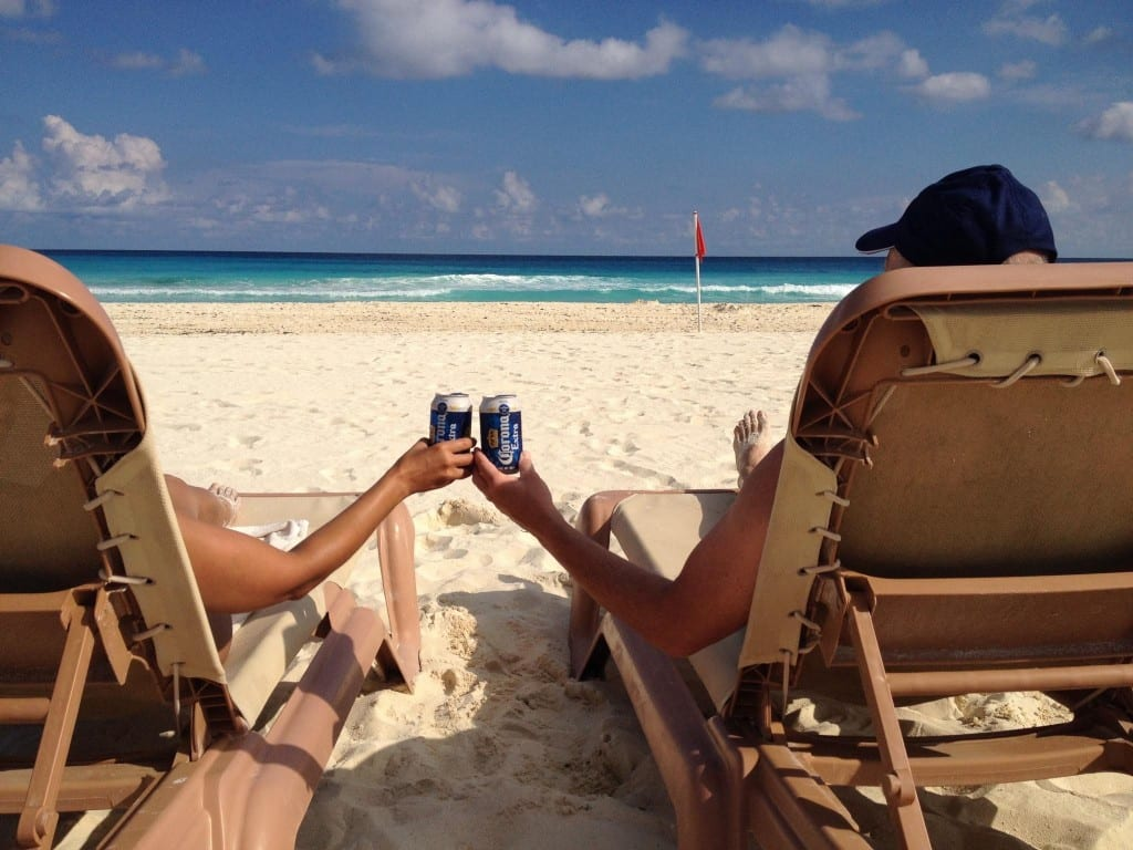 Us on beach chairs with beer cans