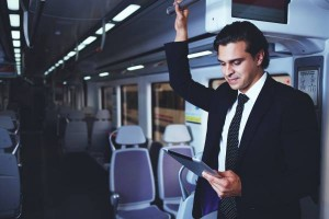Businessman working with tablet on the way to work